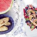 Grilled Jerk spice shrimp with red white and blue berry salad